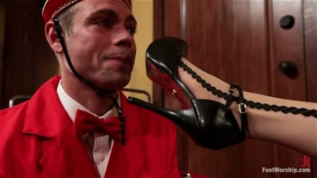 Hotel Guest Maitresse Madeline Dominates the Bellboy in Foot Fetish Video