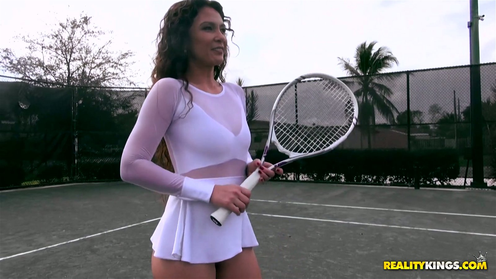 Mature milf playing tennis
