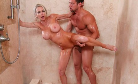 Busty cougar Emma Starr fucks young stud Johnny Castle