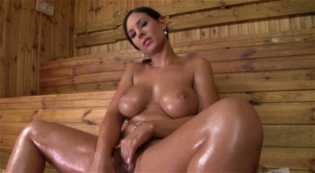 Busty brunette seductress Kyra Hot toys her pussy in the sauna