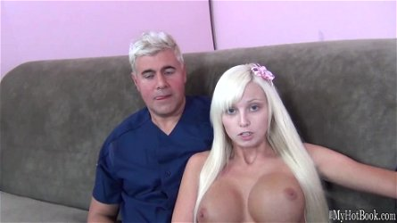 Rikki Six wears her flaxen hair down to perfectly frame her new fake tits.