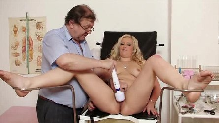 Big-tit blonde Nataly Gold poses in the medicine office