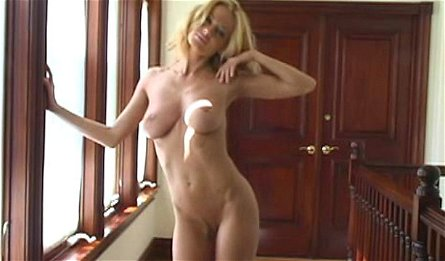 Slender blonde Anita Dark is showing off her boobies