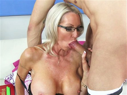 Four eyed busty mommy Emma Starr sucks her lover off with pleasure