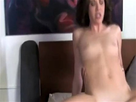 Sexy brunette cougar Katie Angel mounts a big black dong