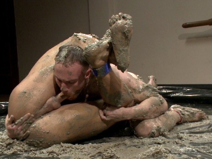 Two gays wrestling and fucking in mud